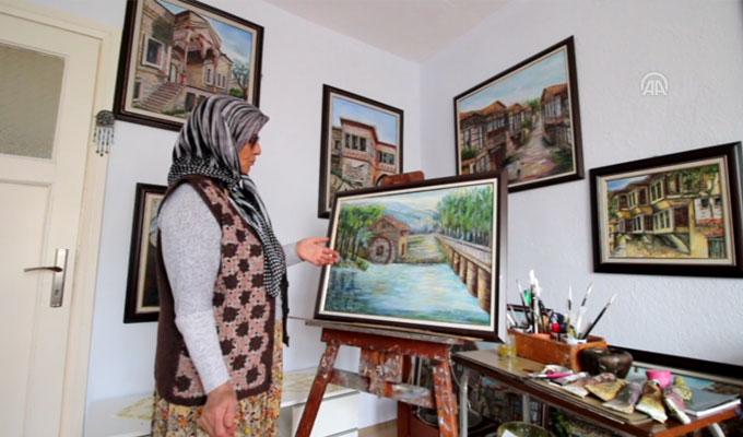 63 yaşındaki ev hanımı 16'ncı resim sergisini açıyor